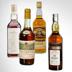 From Left: 1928 Macallan, sold for £17,500 at Bonhams. Calvados 1952, sold for £320 at McTear's. Glenugie 1966, sold for £340 at Mulberry Bank Auctions. Brora 1972, sold for £1,200 at McTear's