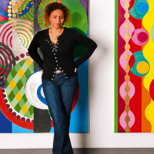 Brazilian artist Beatríz Milhazes stands in front of her triptych Pierrot e Colombina (2009/2010; $800,000) at London's Stephen Friedman Gallery, where her work is showing until November 20.