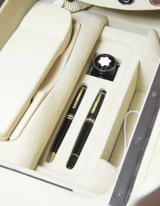 A Montblanc pen set built in to the armrest console