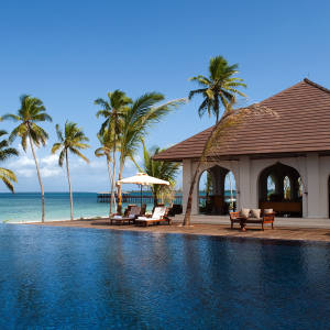 The main pool and Dining Room restaurant at The Residence Zanzibar.