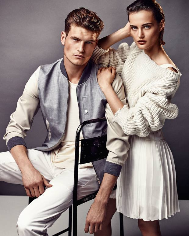 He wears Brunello Cucinelli wool/nylon jacket, £3,087, and cotton trousers, £393. Paul Smith cotton T-shirt, £119. She wears Dior wool jumper, £620, pleated silk crepe dress, £5,100, and cotton voile Lingerie shorts (just seen), £650