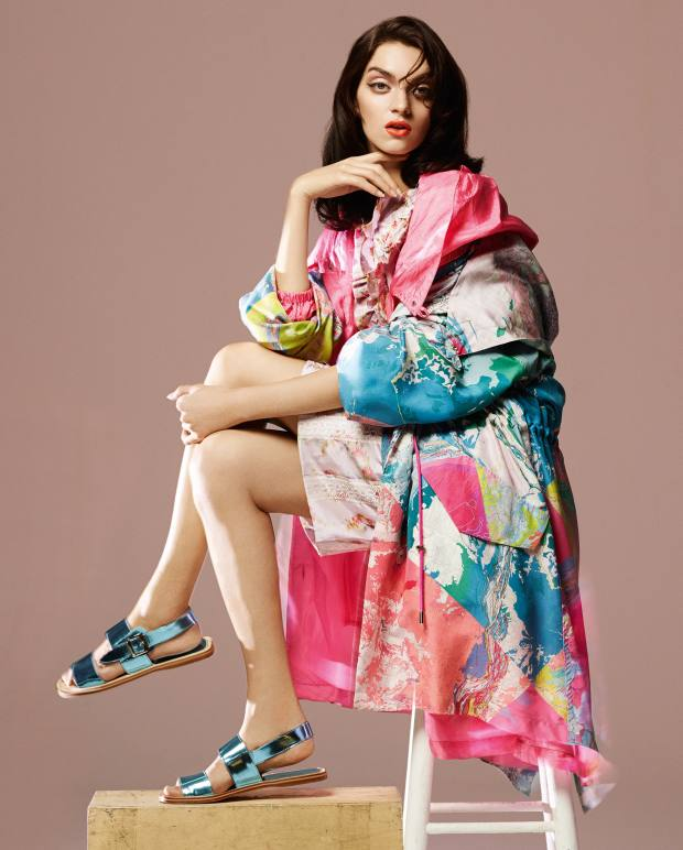 Christopher Raeburn silk parka, £495, and parachute‑silk parka (worn underneath), £895. Miu Miu taffeta top, £595, and matching skirt, £1,010. Manolo Blahnik for Richard Nicoll patent-leather sandals, price on request