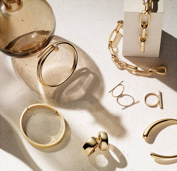 Clockwise from top left: Cartier rose-gold and diamond Juste un Clou bangle, £18,800. Pomellato rose-gold Iconica bracelets, from £7,300. Birks gold Plaisirs ring, £350. Chopard rose-gold Ice Cube ring, £1,130. Jacqueline Rabun gold Mercy bangle, £3,635. Pomellato rose-gold Iconica rings, from £1,720. H Stern gold and diamond Signature HS bracelet, £4,400. Props: Pols Potten bubbles & bottles, £225 for four, from amara.com