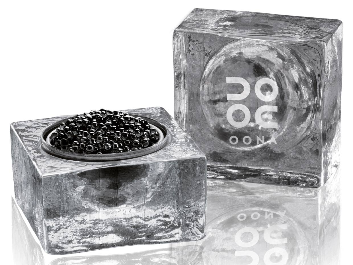 A tin of No 103 Traditional caviar nestled in the distinctive glass Ice Cube container