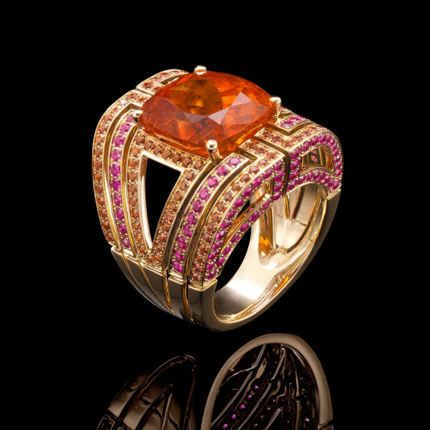 Robinson Pelham's bespoke commissions, from £6,000, have included this 18ct-yellow-gold ring set with orange and pink sapphires