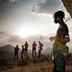 Men from the Mursi tribe on stilts in the culturally diverse Omo Valley