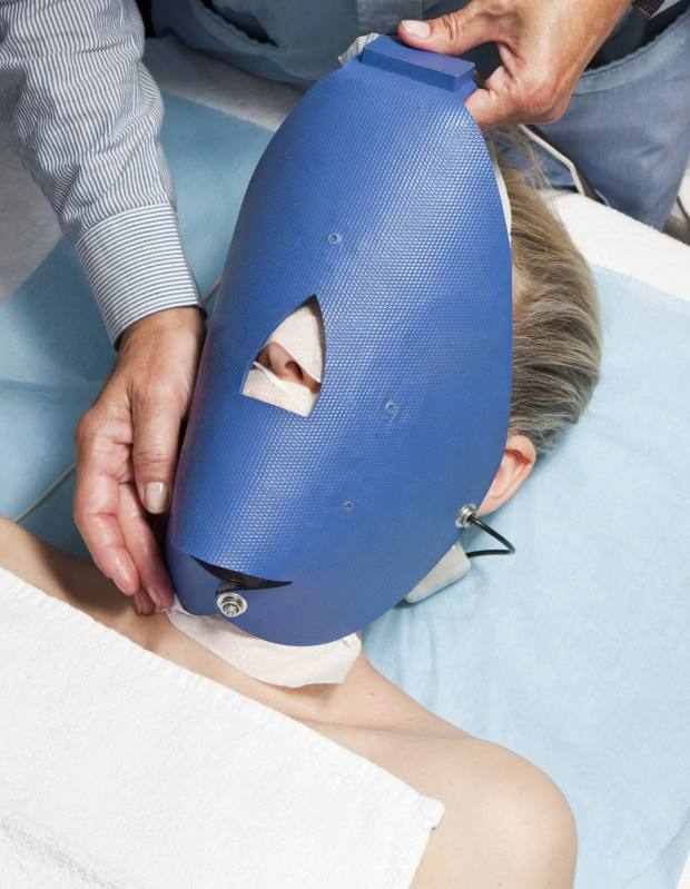 Dr Véronique Simon's Heating Facial Mask being applied to a mesotherapy treatment.