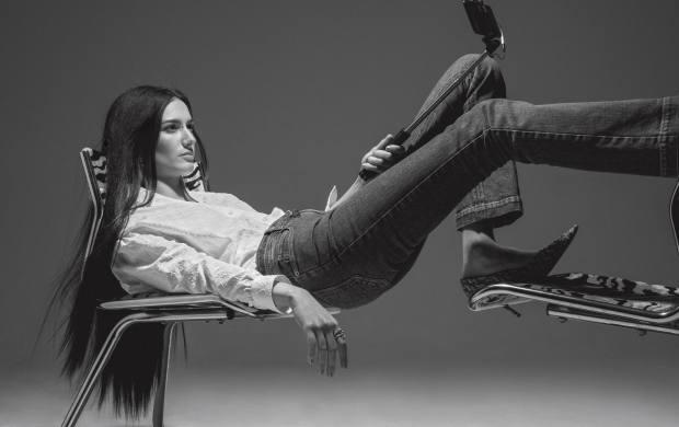 Louis Vuitton silk shirt, £1,030, and denim jeans, £950. Jimmy Choo glitter leather Love 85 heels, £550
