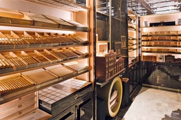 The humidor room at the Wellesley hotel in Knightsbridge, which haslacquered wood walls