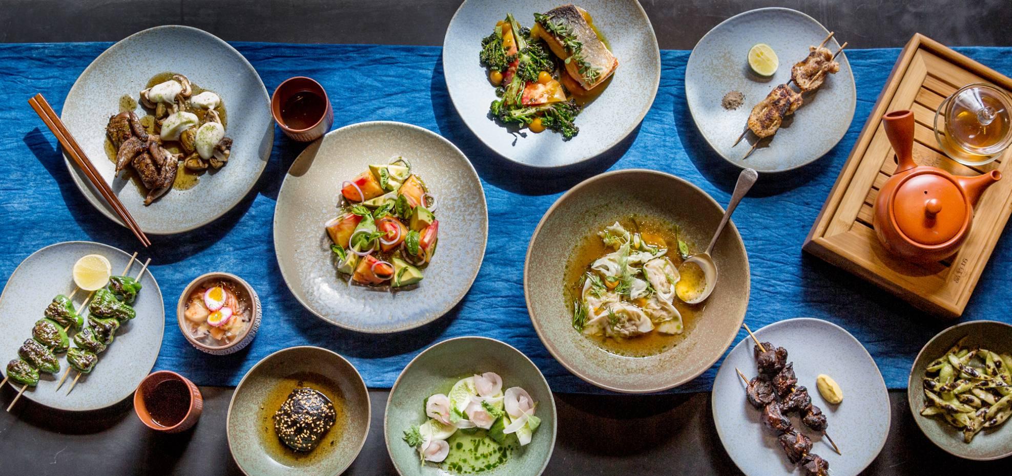 Food options include sharing plates of vegetarian bites, skewers of meat and dumplings