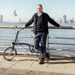 Jamie Ritchie by the Hudson River with his Brompton bike