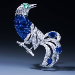 c1950 Cartier platinum, gold, sapphire, emerald and diamond bird of paradise brooch from Epoque Fine Jewels, price on request
