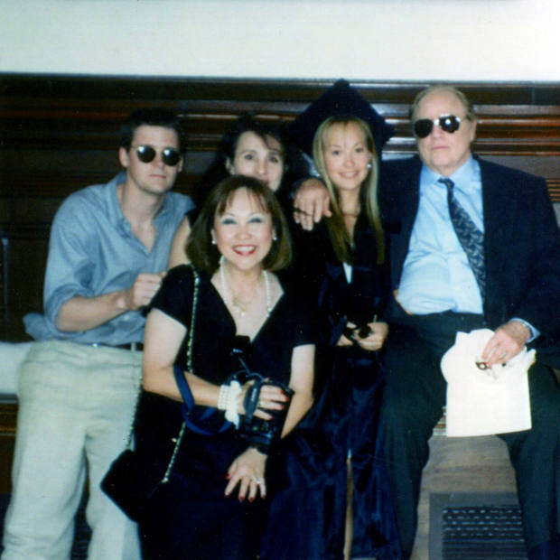 Brando pictured with his daughter Petra and her mother, Caroline Barrett, at Petra's graduation in 1994, when Brando gave her the Rolex
