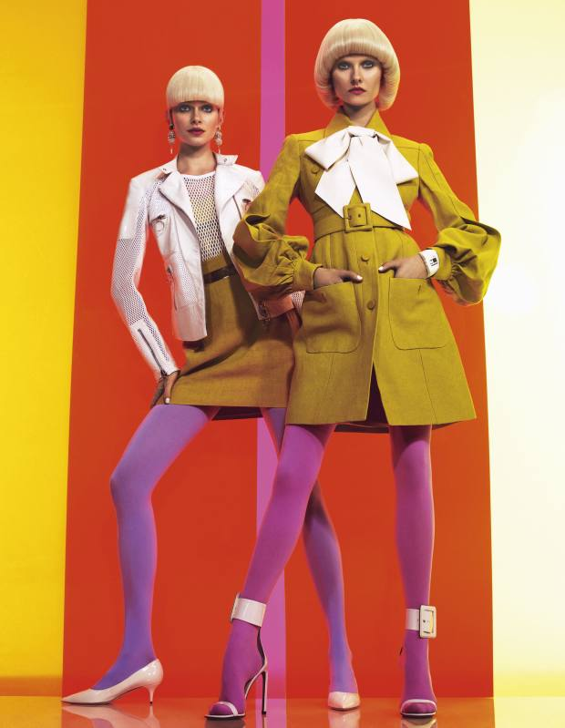 Karo (right) wears patent-leather, cotton and wool-mix jacket, £1,130, and wool and cotton tank top, £120, both by Versus. Linen racer-back top (worn underneath), £455, and linen skirt, £370, both by Gucci. Leather and metal belt, £30, by Aqua by Aqua. Nylon tights, $10, by We Love Colors. Patent-leather shoes, £335, by Jimmy Choo. Metal and crystal earrings, $195, by Laruicci. Kamila (far right) wears belted linen coat, £1,720, and patent-leather shoes, £475, both by Gucci. Bow, stylist's own. Nylon tights, $10, by We Love Colors. Polyurethane and stainless-steel Zub Zoo 40 watch, £99, by Nooka