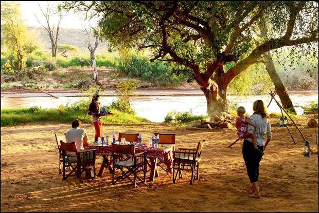 Conservationist Saba Douglas-Hamilton and her family dining on the banks of the Ewaso Nyiro River, Kenya