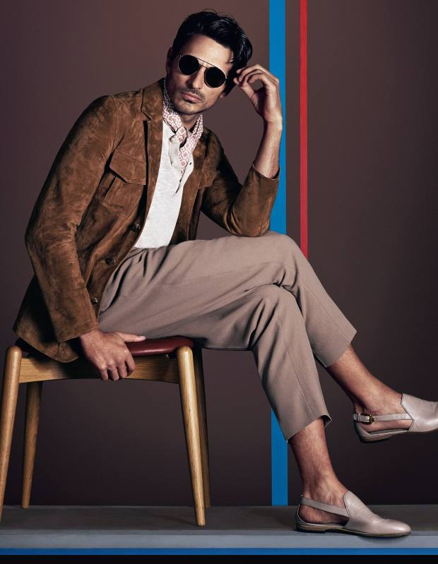 Dunhill suede safari jacket, £3,350. Michael Kors cotton/linen polo shirt with suede pocket, £110. Versace wool trousers, about £452, and leather shoes, £499. Eye Respect sunglasses, £185. Gieves & Hawkes cotton scarf, £250Carl Hansen oak and leather CH20 Elbow chair, from £533, from Skandium