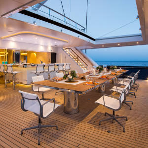 The dining area on the main deck of the 86m sailing yacht Aquijo