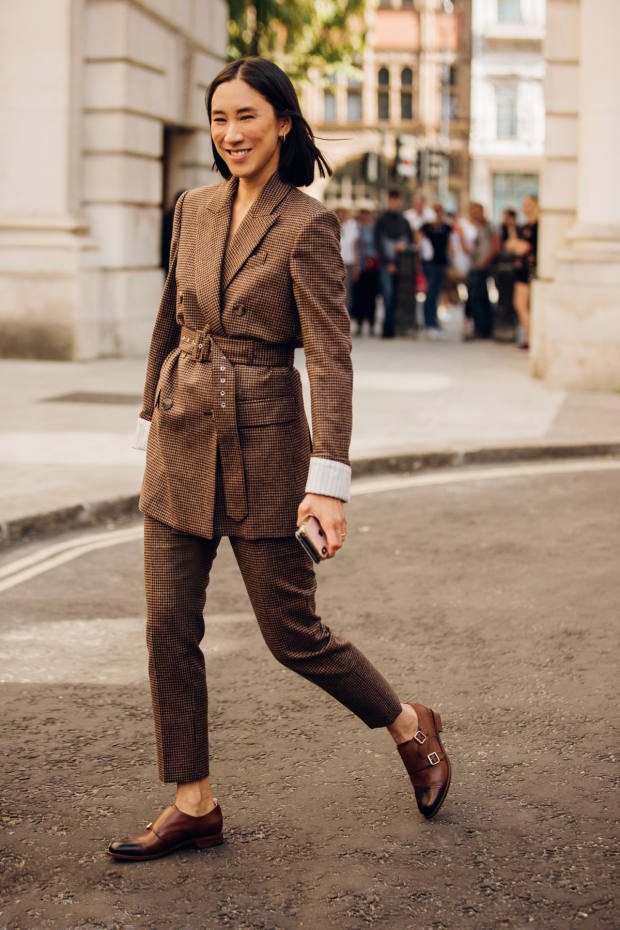 Eva Chen wears a Racil double-breasted houndstooth suit jacket and trousers