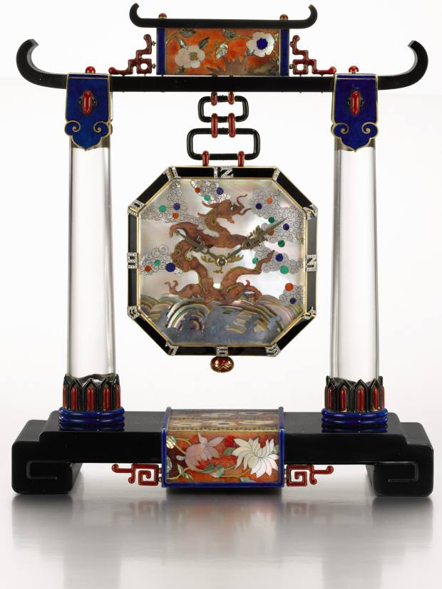 Vacheron Constantin's bejewelled art deco clock (£250,000-£400,000), in the form of a Chinese temple portico, crafted from rock crystal, coral, mother-of-pearl and black onyx