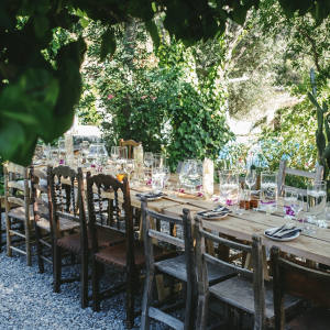 Guests enjoy La Finca's dining experience at rustic tables scattered across leafy terraces