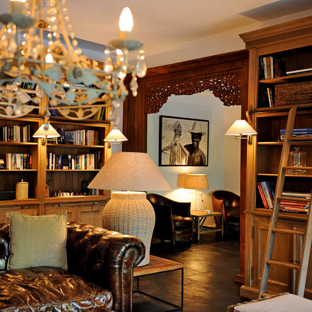 A book-lined lounge at 20 Degrés Sud