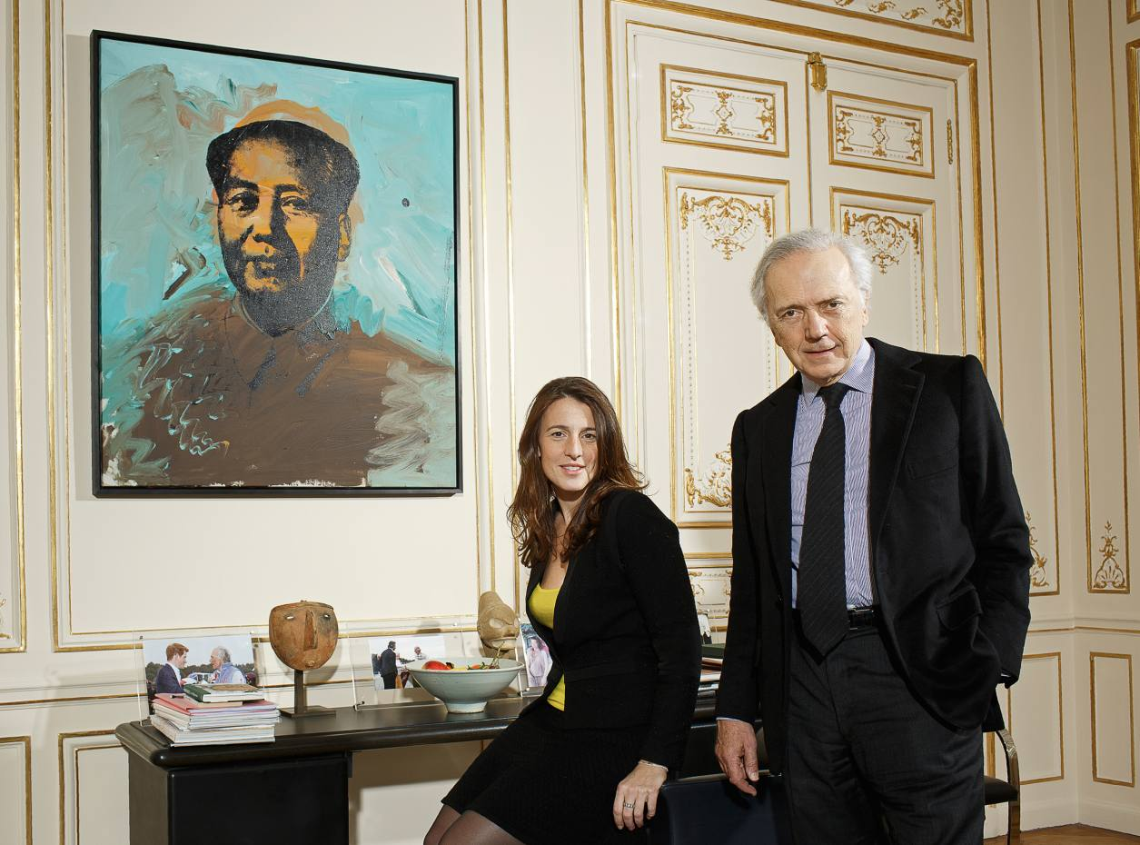 Edouard Carmignac and Gaïa Donzet in Carmignac's Paris office, with Andy Warhol's Mao, 1973, in the background