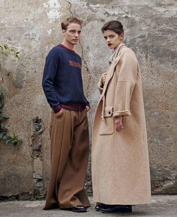 He wears Qasimi wool/cashmere jumper, £395, and cotton-denim trousers, £460. Church's leather Shannon Derby shoes, £530. She wears Joseph wool/cashmere Booth coat, £1,195, and silk Birley dress (just seen), £795. Church's leather Shannon Derby shoes, £380