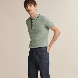 King & Tuckfield merino-wool polo shirt, £170, and denim Joe-style jeans, £225