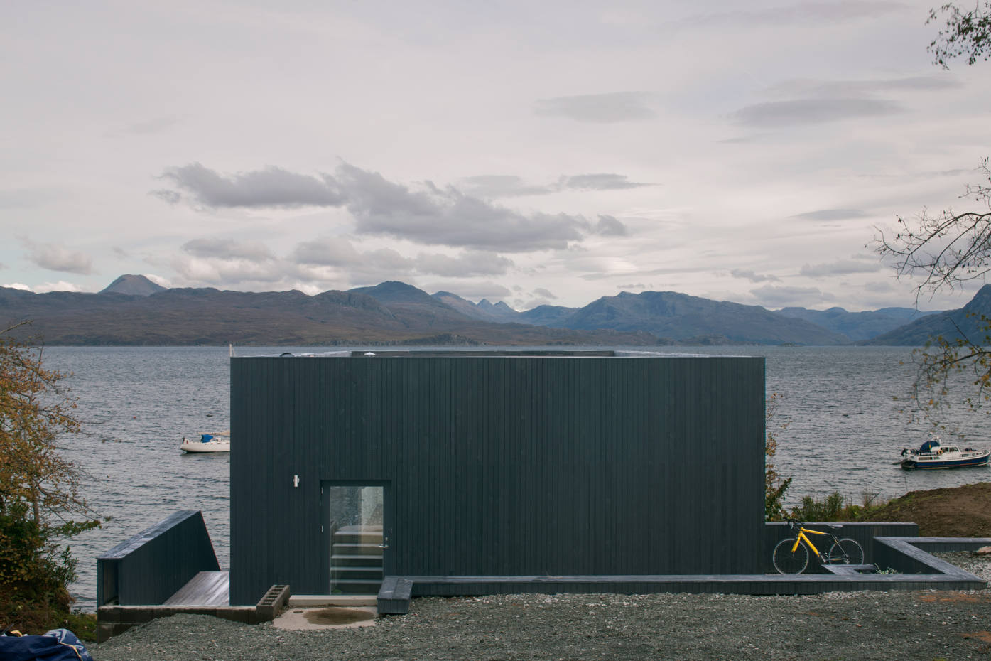 This house on the Isle of Skye by Dualchas Architects has a gable of glass overlooking the water