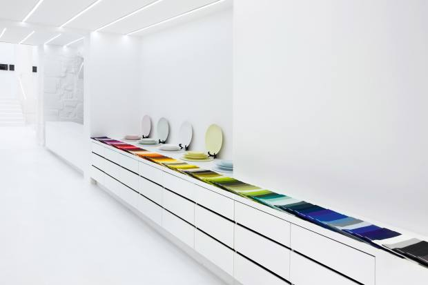A colour-grouped display of plates and linens in Grateau's Paris boutique