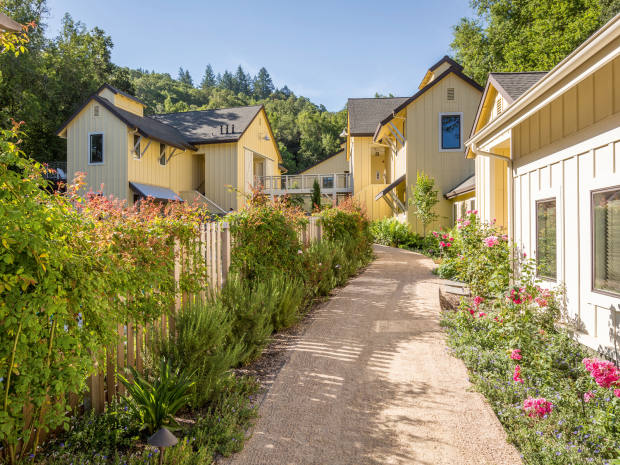 The butter-yellow, two-storey additions to Farmhouse Inn, in Russian River Valley