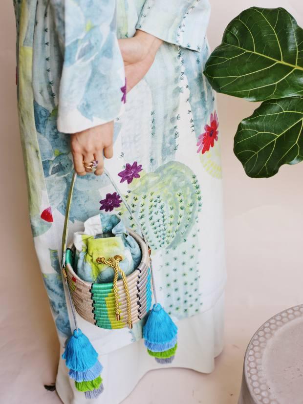 Maison Alma linen Cactus kimono wrap coat, $2,400, and El Cactus woven bucket bag, $700