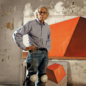 Christo in his studio with a preparatory drawing for The Mastaba, New York City, 2012