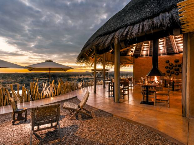 The alfresco dining room at Omaanda, where the lodge accommodation is based on traditional Owambo thatched-roof and clay tribal huts