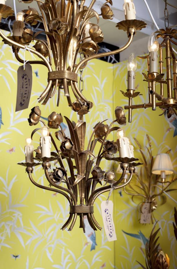 Brass candlestick chandeliers from £285