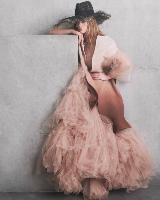 Dior wool coat, £3,800, and polyamide dress, £18,000. Harvy Santos abaca straw and grosgrain ribbon Dishevel hat, £672