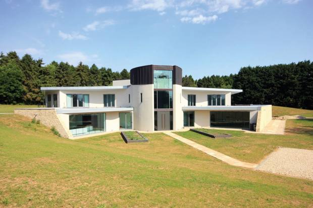 A five-bedroom villa in Gloucestershire encircled by mature woods, £3.3m, through Hamptons