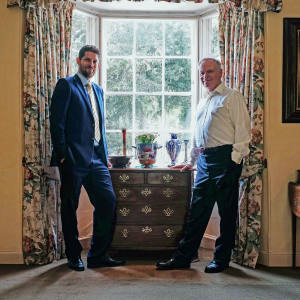 From left: Martin Millard with Jeffery Archer at Archer's 17th-century former rectory with, from left, a Moorcroft bowl; a c1905-10 tall Pomegranate vase; a c1905 Claremont jardinière; a c1905-10 Pomegranate pedestal bowl; a c1900 floral-themed Macintyre vase; and c1900 Macintyre Poppy Florian solifleur vase