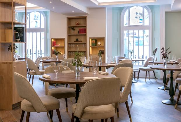 The contemporary decor and table settings reflect Smyth's concept of modern British food