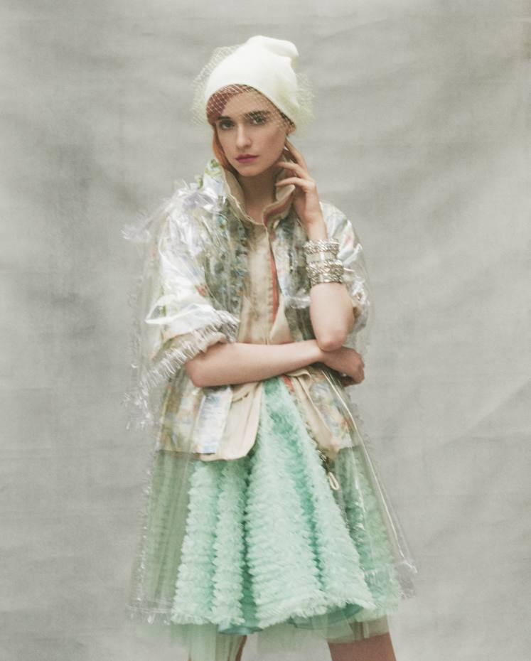 Chanel PVC cape, £1,850. Giorgio Armani silk organzajacket, £2,650. Dsquared2 tulle shirt, £550, and tulle petticoat, £705. Wool and nylon veil beanie created on set by Harvy Santos. Catface Hair wig, £450. Left arm from top:Chanel metal, strass and resinbracelets, £640 each, andmetal and strass bracelets,£920 each