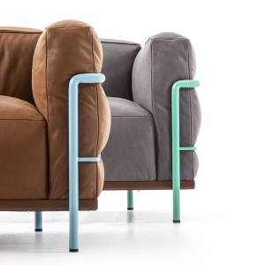 The CP edition has a light-blue tubular frame and soft brown leather upholstery