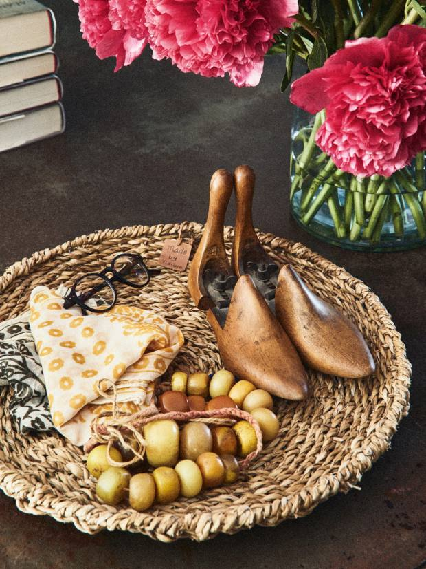 A basket of accessories in Brown and Konig's home