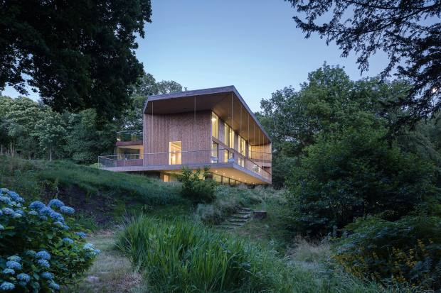 Red Bridge House, by Piers Smerin of Smerin Architects, is set amid 22 acres of woodland in East Sussex