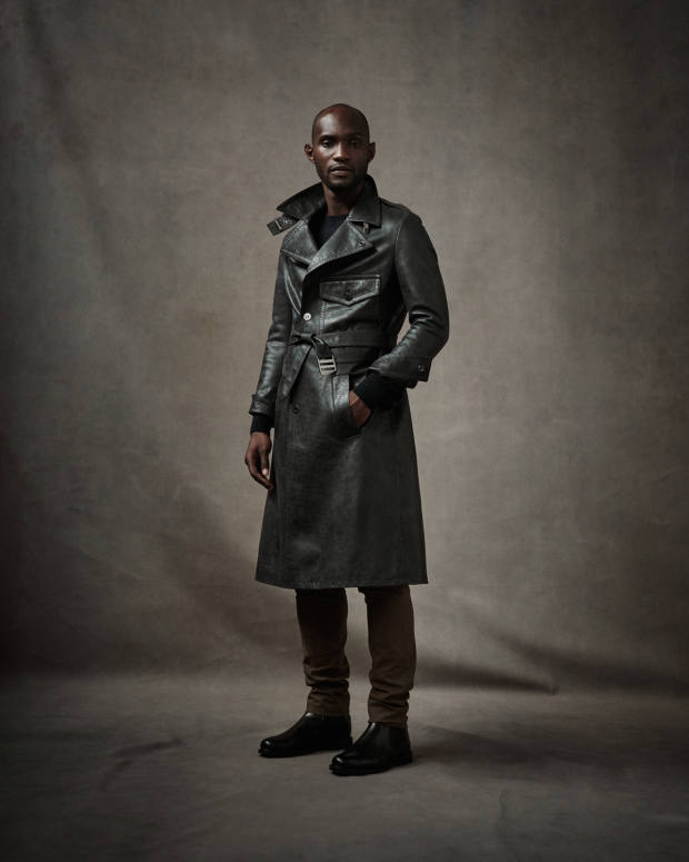 Neil Barrett leather coat, £5,500. Loro Piana cashmere jumper, £1,015, and stretch-cotton trousers, £450. Church's leather Wells boots, £450