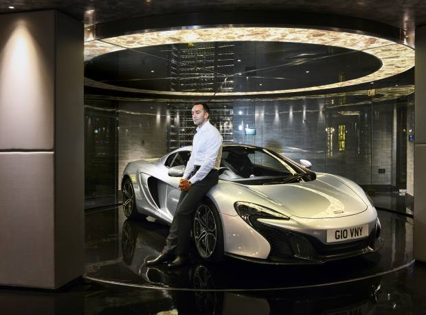 David Giovanni in his basement garage with his McLaren 650S on a rotating turntable