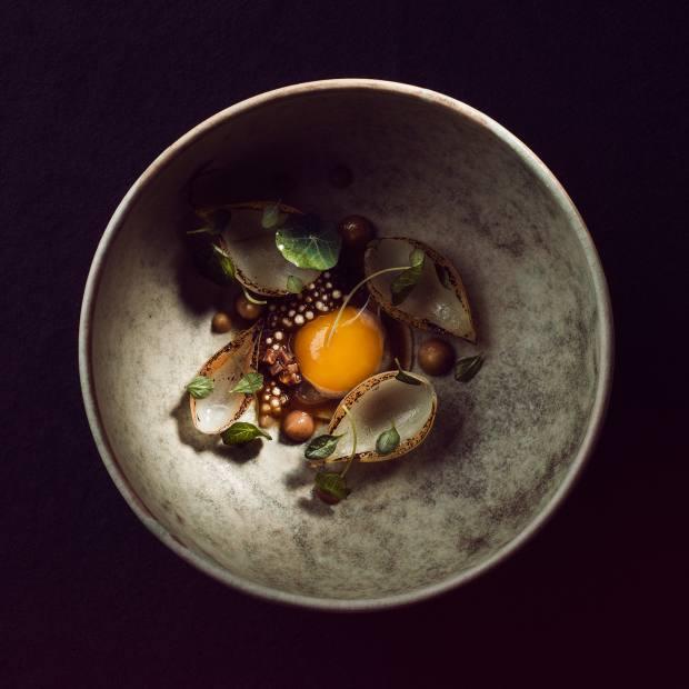 A dish of quail egg and sheep's thigh at Maaemo
