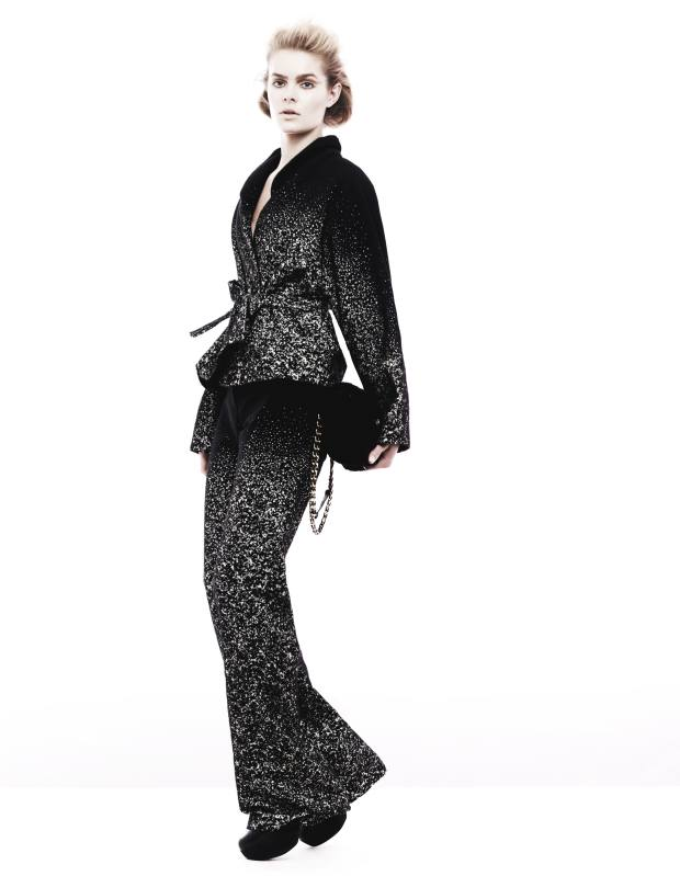 Wool jacket, £1,365, and matching trousers, £770, both by Maria Grachvogel. Leather shoes, £1,160, by Yohji Yamamoto. Shearling baguette bag, £2,080, by Fendi