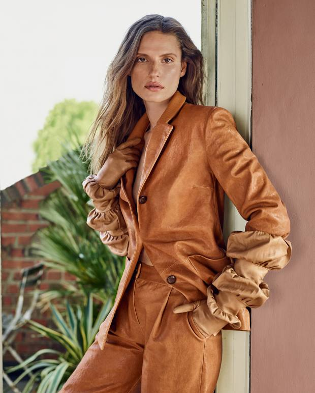 Trussardi leather jacket, about £1,285, and matching trousers, about £875. Paula Rowan leather Monserrat Bubble gloves, about £438