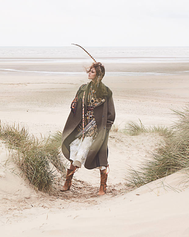 Maison Margiela wool coat, £2,605. Huishan Zhang silk‑organza and polyester Victoria dress, £1,805. Ulla Johnson cotton/silk-mix Dune blouse, €490. Aquazzura suede Bohemia boots, £1,550. VV Rouleaux pheasant feather, £39.95. Rockins silkscarf (worn over right shoulder), £150. Pebble London silk pompom belt, £220, Afghan cloth and bead belt, £110, Afghan cotton, glass-bead, metal-stud and coin belt, £145, silver and amber necklace, £220, and gold-plate, oynx and silk necklace, £240. Gillian Horsup metal and glass-stonebrooch, £75. Butler &Wilson gold-plate and Swarovski-crystal Tiger brooch, £38. Sonia Petroff gold, palladium, brass and stone Scarab brooch, £269