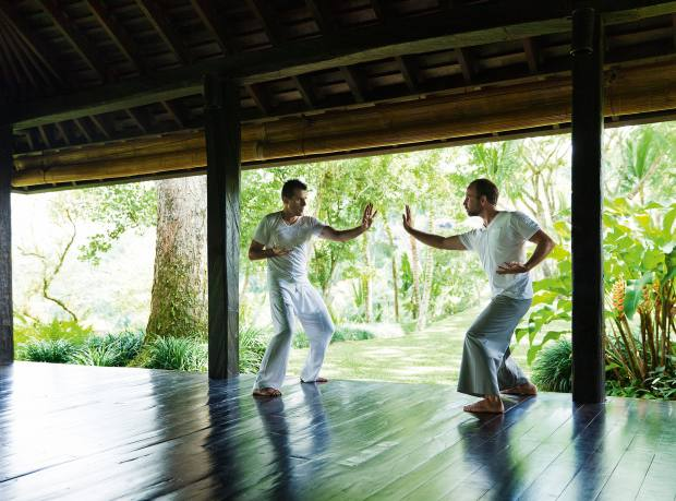 Jeffrey Bomes (left) and David Melladew doing qigong